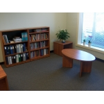 Attractive end table, coffee table and bookcases in Oiled Cherry
